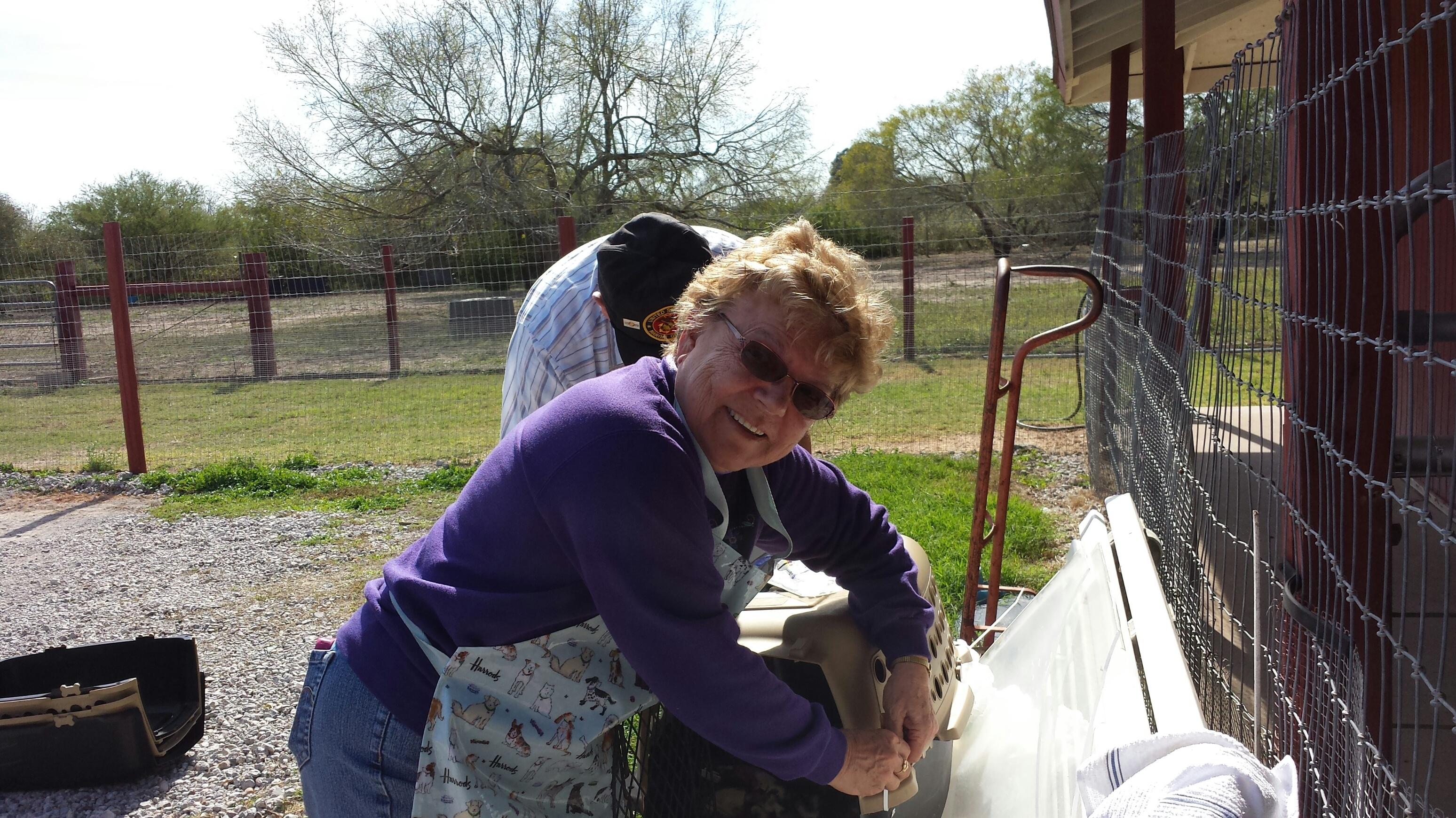 Dortothy putting cages together